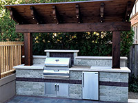 Built-in Barbeque. Unilock stone and accents with Firemagic Grill and Natural stone countertop