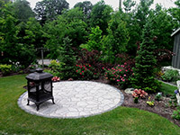 Firepit Patio. Permacon Mega Arbel Circle Patio with Cast Iron Firepit