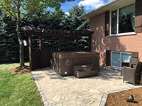 Hot-tub Patio. Stone patio with Beachcomber hottub and cedar structure